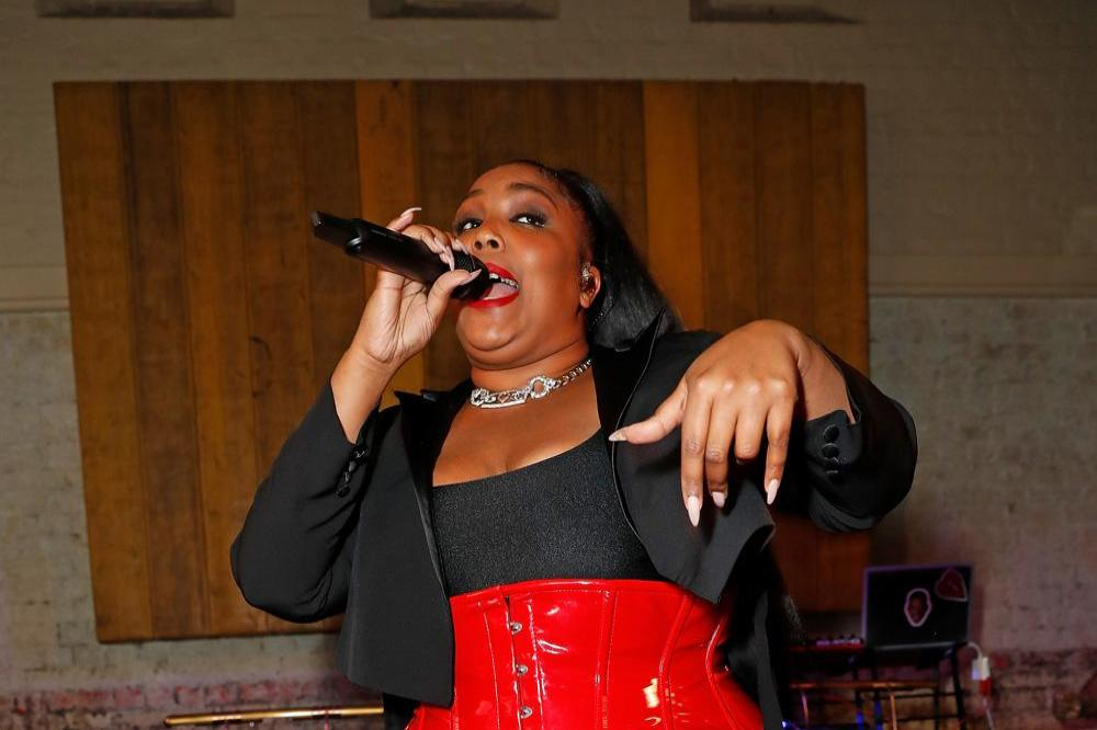 Lizzo performs at Warner Music and CÎROC Vodka party