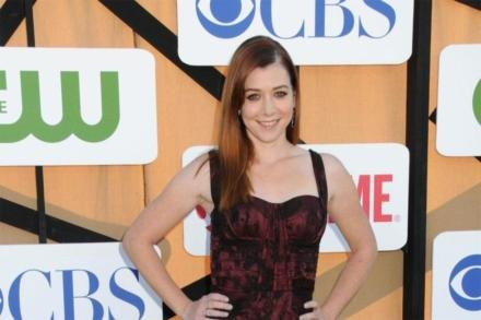 Alyson Hannigan shows off her ring at the CW, CBS, Showtime 2013 summer party in Los Angeles