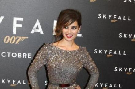 At the Paris première in an Elie Saab Fall 2012 gown