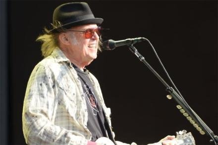 Neil Young performing in Hyde Park