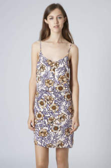 Trending now at topshop a floral dress from topshop is perfect for layering with chunky knitwear thick socks and knee high leather boots mightylinksfo